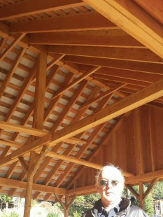 Brian in front of roof built with Skunk lumber